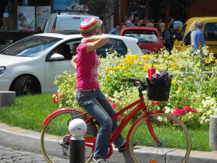 Girl on a red bike